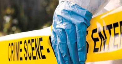 Línea amarilla de la Policía Nacional, delimitando la escena del crimen