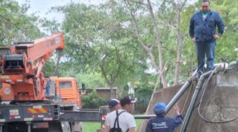 Trabajadores de ENACAL durante la restauración del servicio de agua potable en la Pacayita, Masaya.