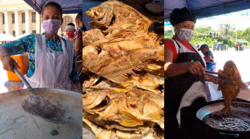 Vendedores de mariscos ofreciendo sus productos en la plaza 22 de Agosto de Managua