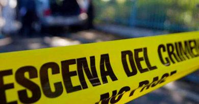 Línea amarilla que dice escena del crimen