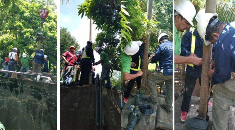 Trabajadores de ENACAL durante la rehabilitación del servicio de agua potable en Pacayita, Masaya